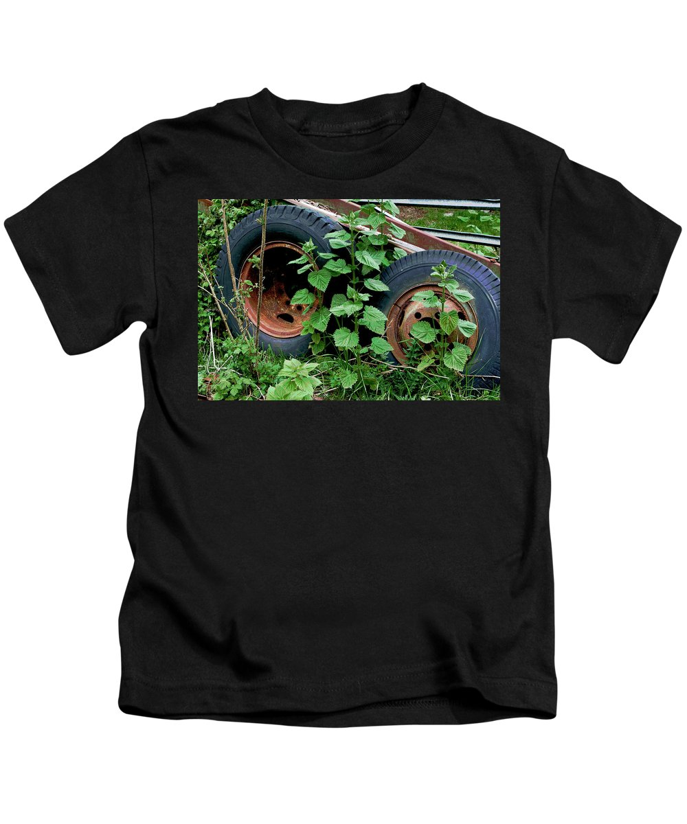 Tires Kids T-Shirt featuring the photograph Tires And Ivy by Lorraine Devon Wilke