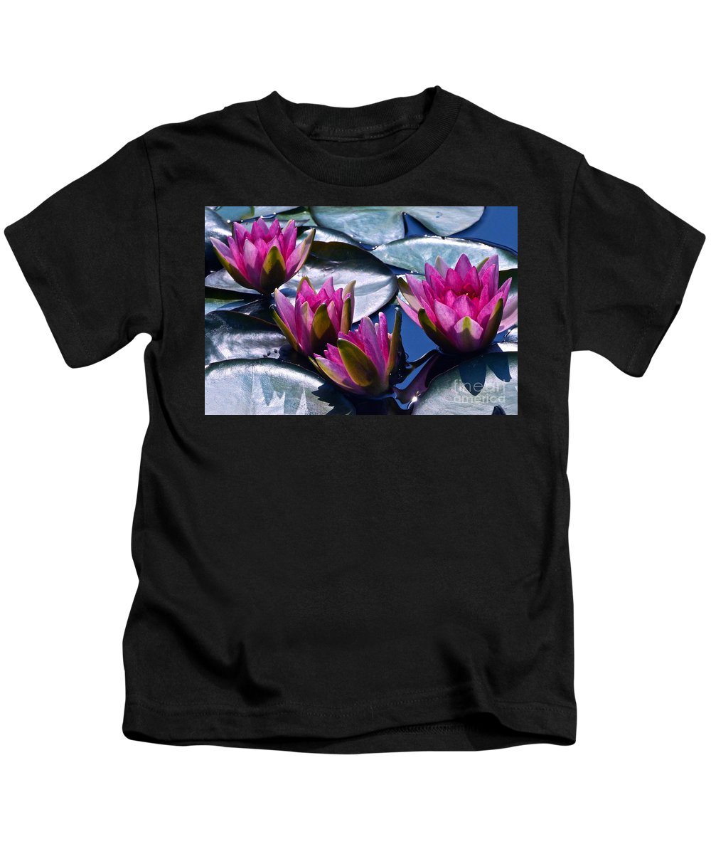 Hardy Garnet Waterlily Kids T-Shirt featuring the photograph Waterlilies In Bright Sunlight by Byron Varvarigos