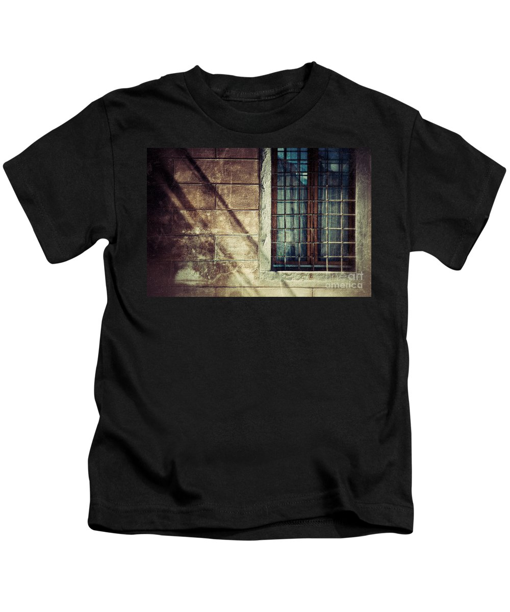 Architecture Kids T-Shirt featuring the photograph Window and long shadows by Silvia Ganora