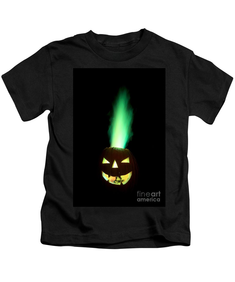 Pumpkin Kids T-Shirt featuring the photograph Colored Flame In Burning Pumpkin by Ted Kinsman