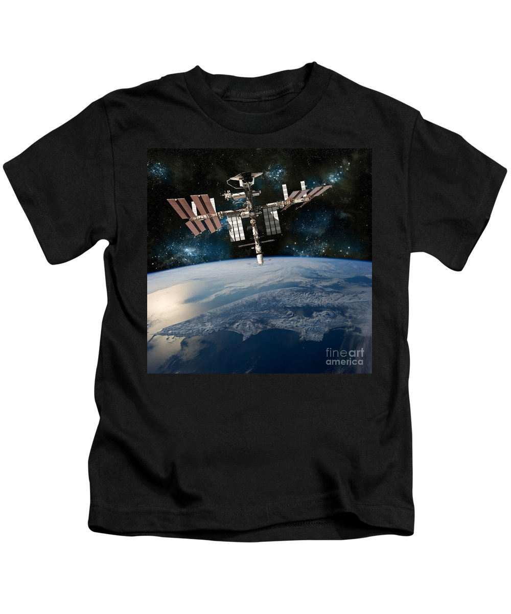 American Kids T-Shirt featuring the photograph Shuttle Docked At Space Station by Marc Ward