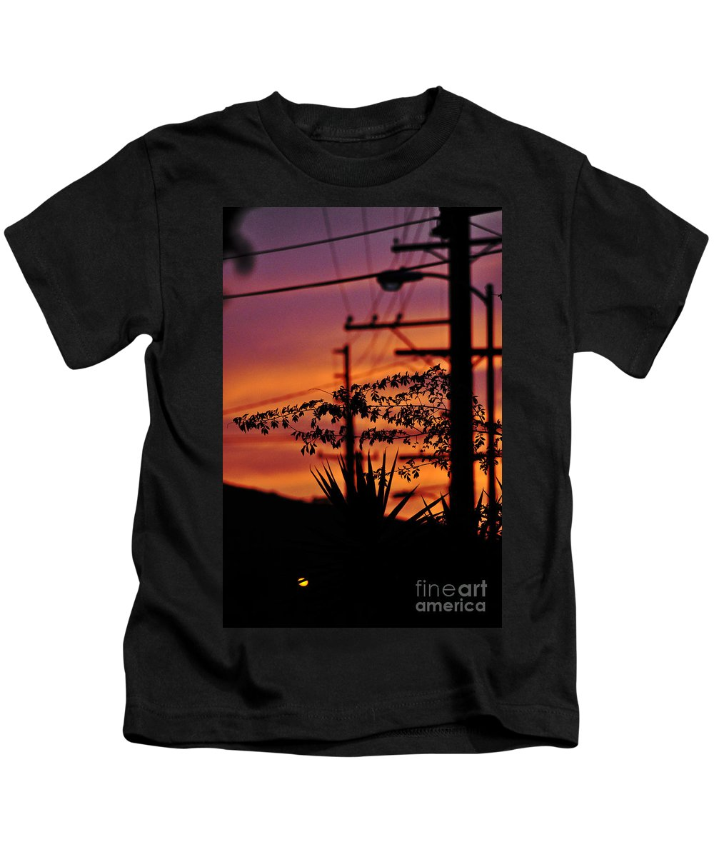 Clay Kids T-Shirt featuring the photograph Sunset Sihouettes by Clayton Bruster