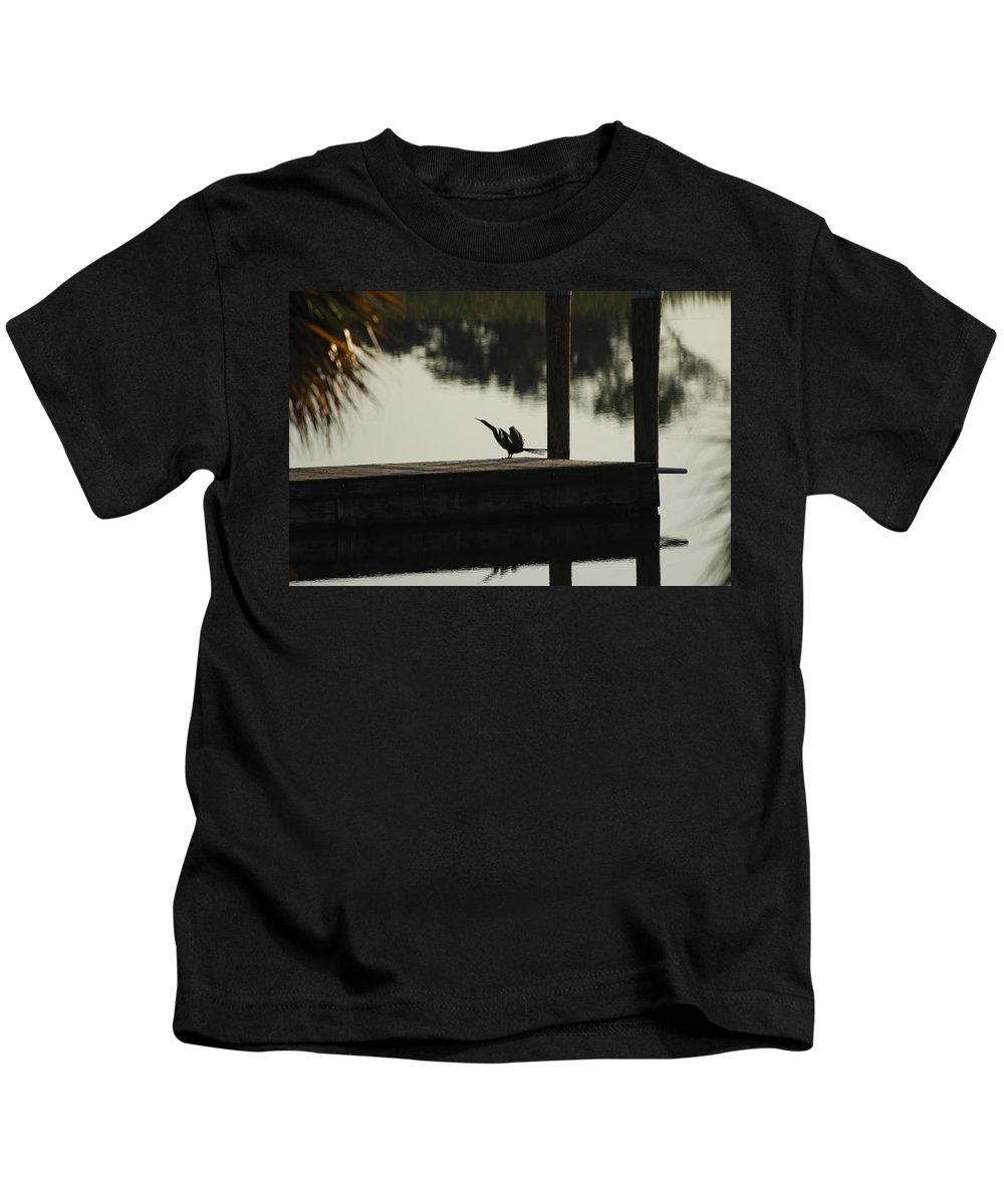 Reflections Kids T-Shirt featuring the photograph Dock Bird by Rob Hans