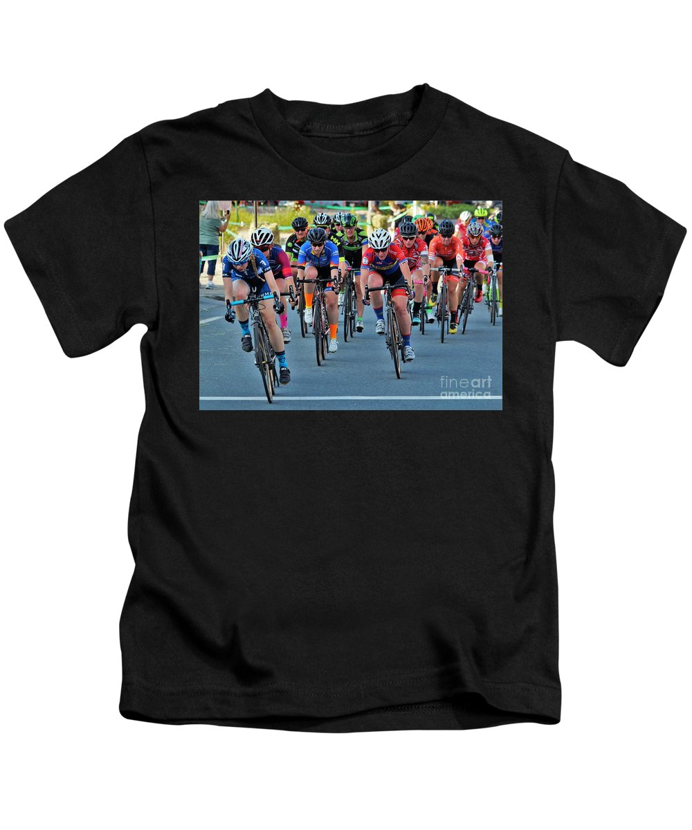 Kids T-Shirt featuring the photograph Fearless Femme Racing by Donn Ingemie
