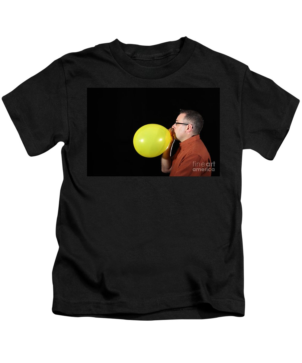 Person Kids T-Shirt featuring the photograph Man Inflating Balloon by Ted Kinsman
