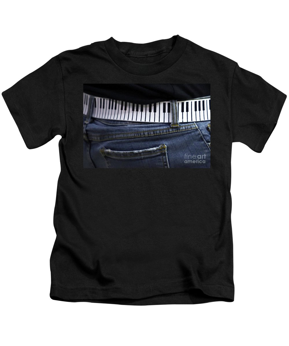 Acoustic Kids T-Shirt featuring the photograph A Belt Of Cords by Alan Look
