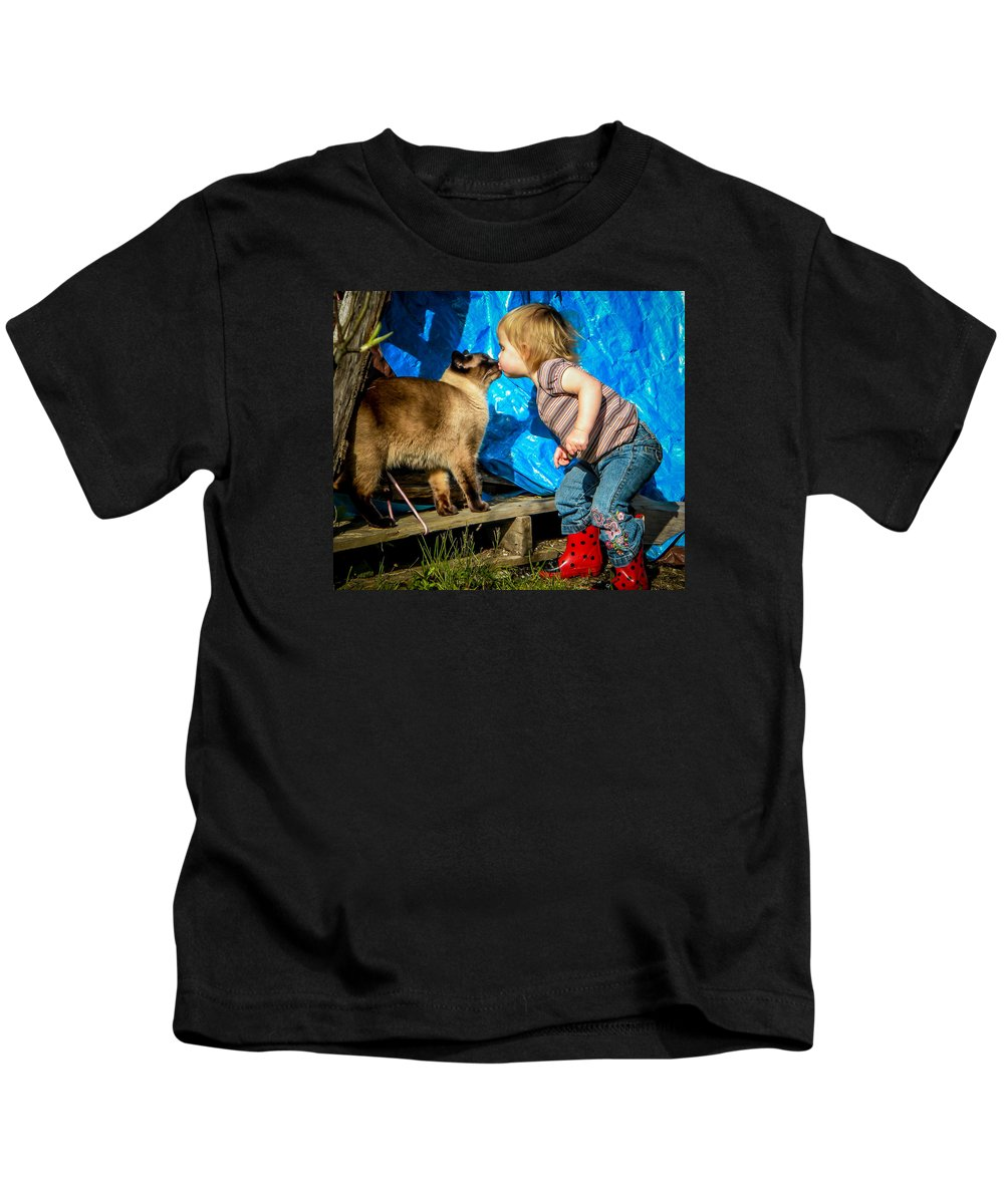 Kids T-Shirt featuring the photograph A Girl And Her Cat by Reed Tim
