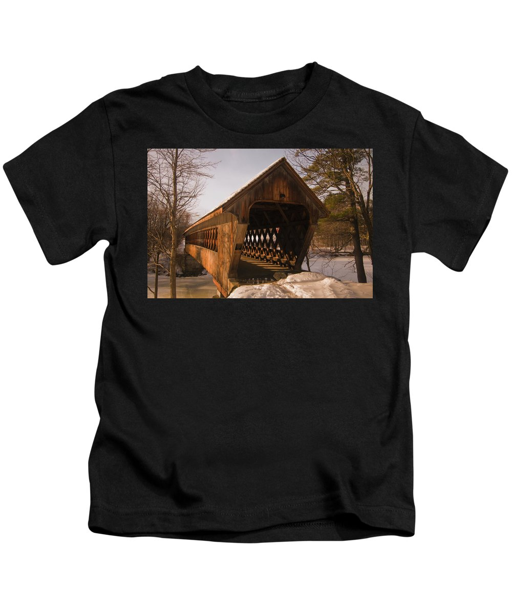 new England Covered Bridges Kids T-Shirt featuring the photograph A Winters Walk by Paul Mangold