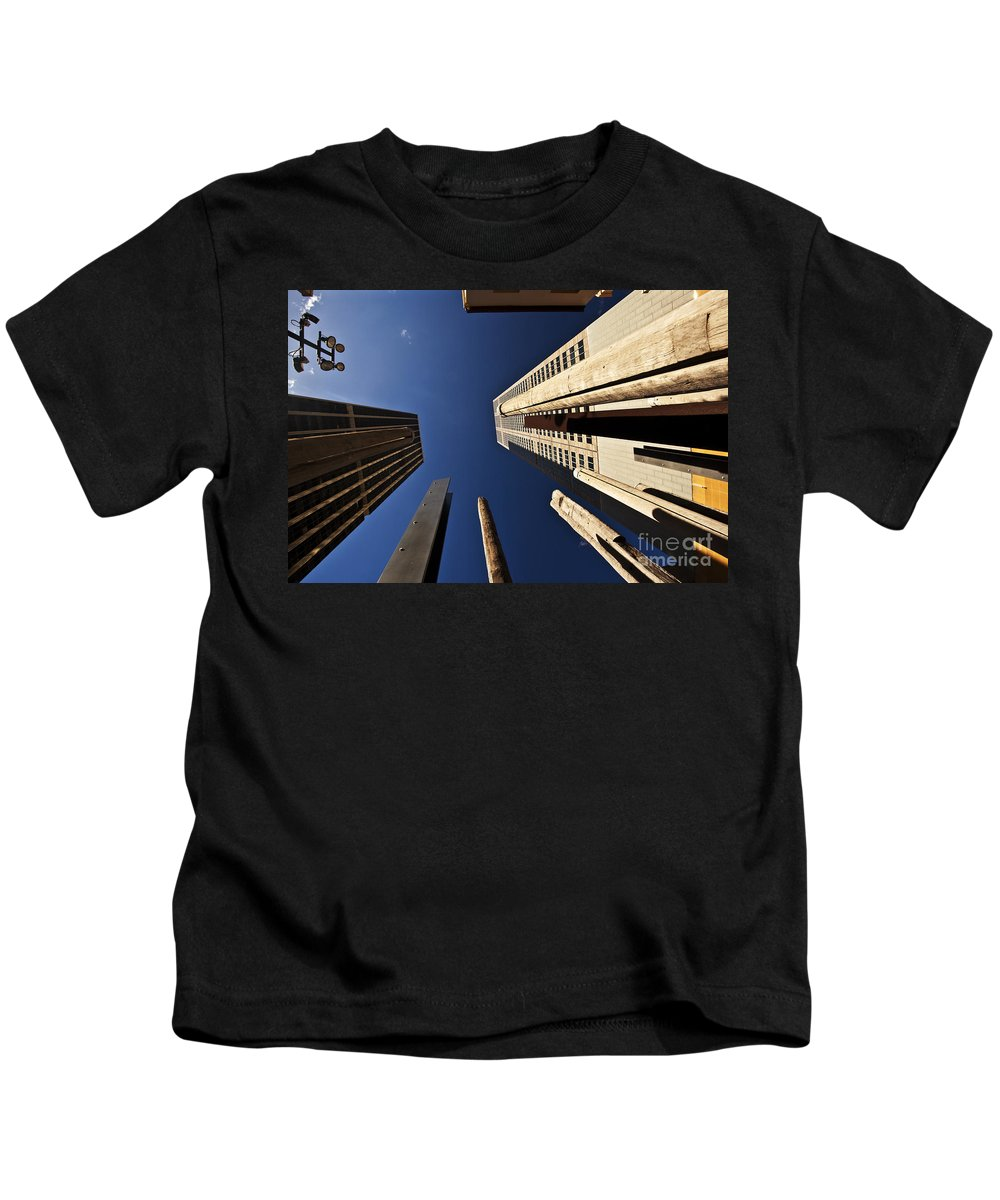Australian Aboriginal Sound Poles Skyscrapers City Kids T-Shirt featuring the photograph Aboriginal Sound Poles by Sheila Smart Fine Art Photography