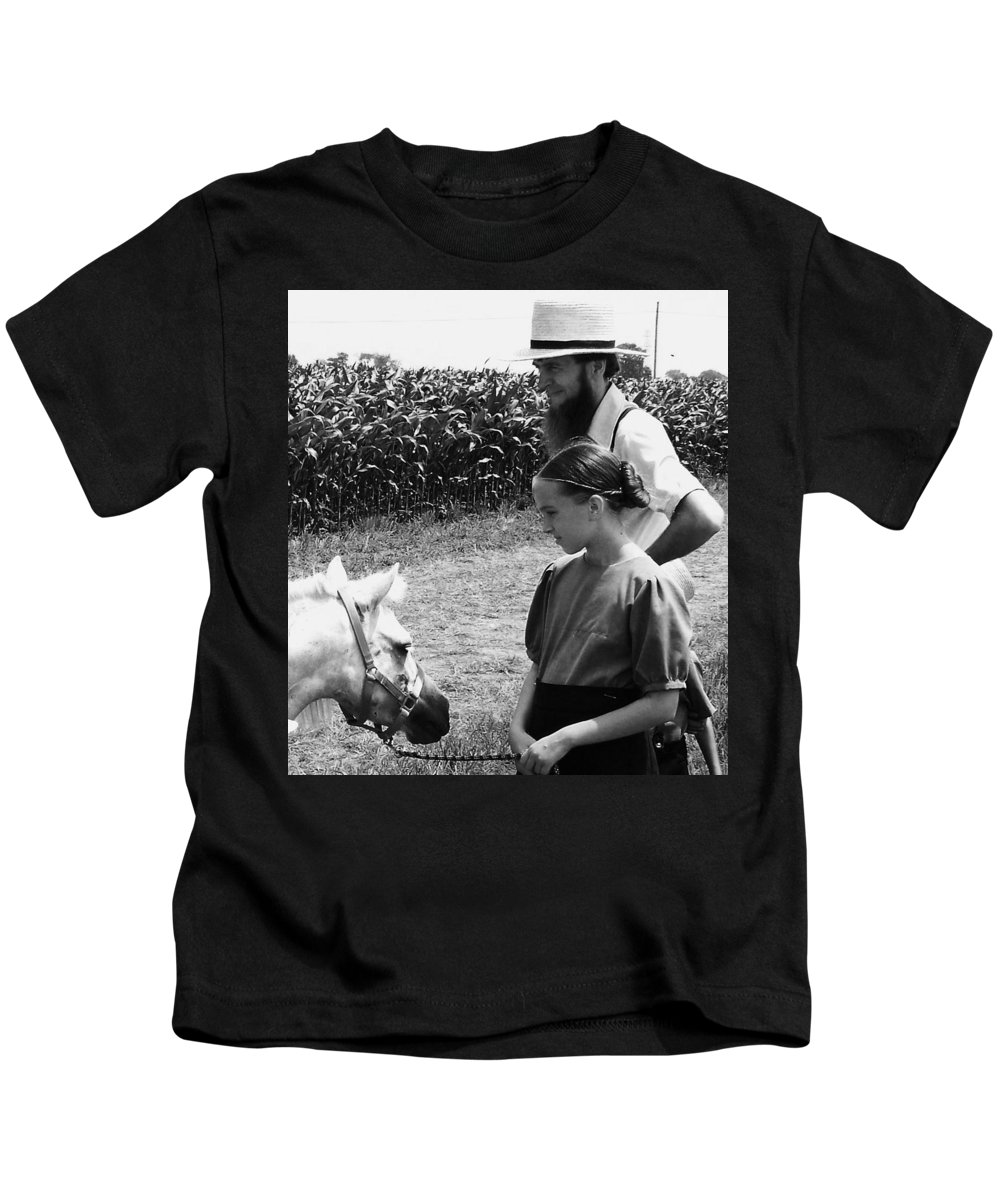 Amish Kids T-Shirt featuring the photograph Amish Girl And Pony by Eric Schiabor