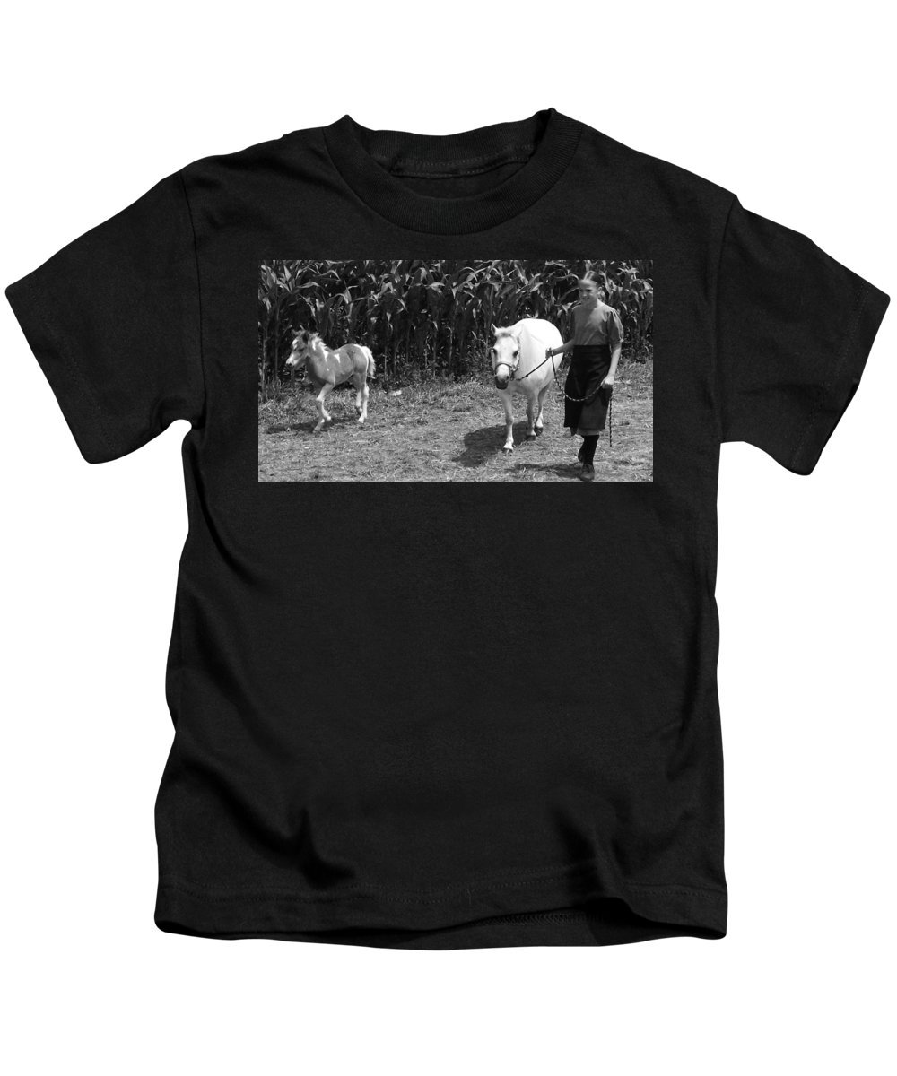 Amish Girl With Her Colt Kids T-Shirt featuring the photograph Amish Girl With Her Colt by Eric Schiabor