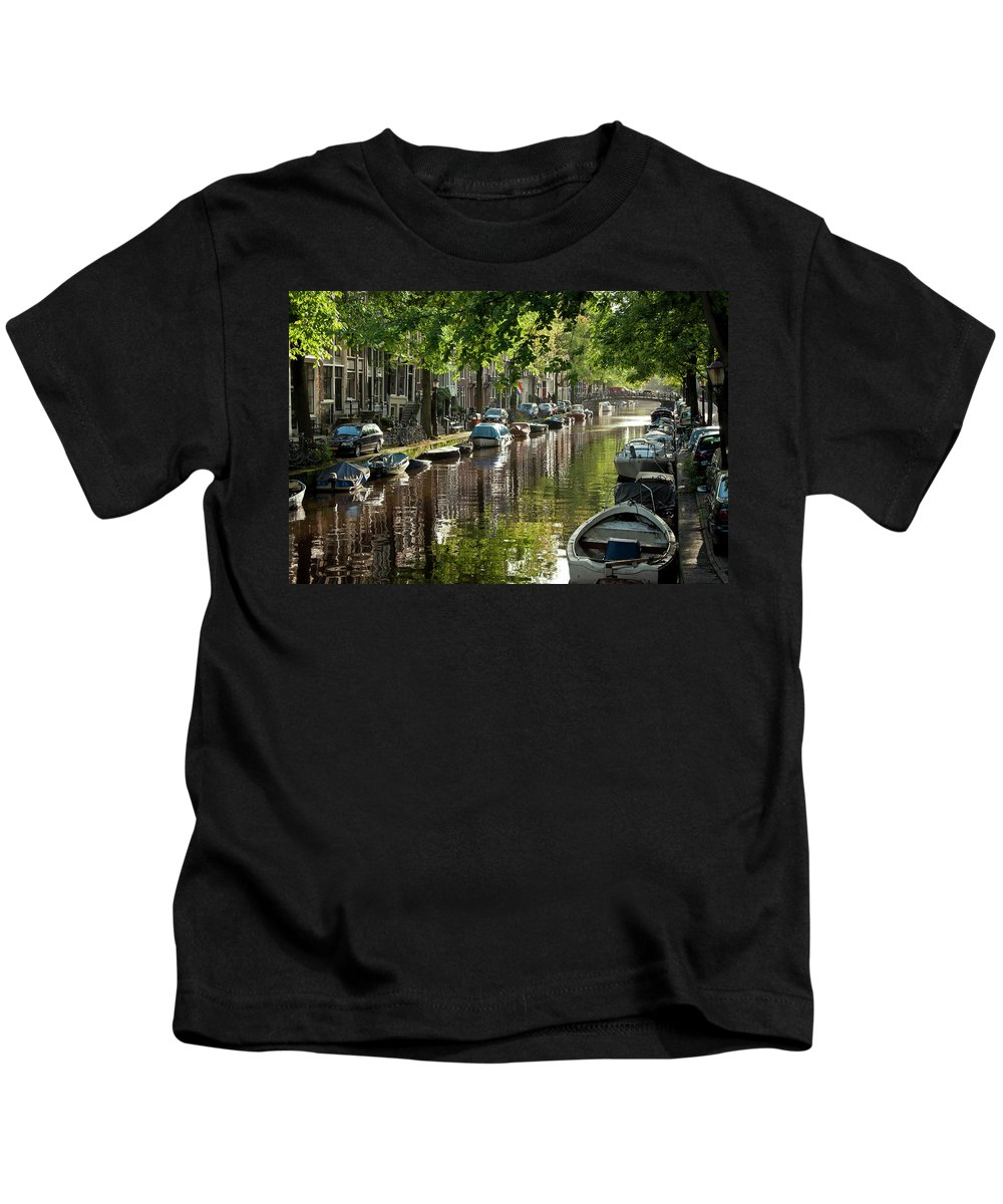 Age Kids T-Shirt featuring the photograph Amsterdam Canal by Joan Carroll