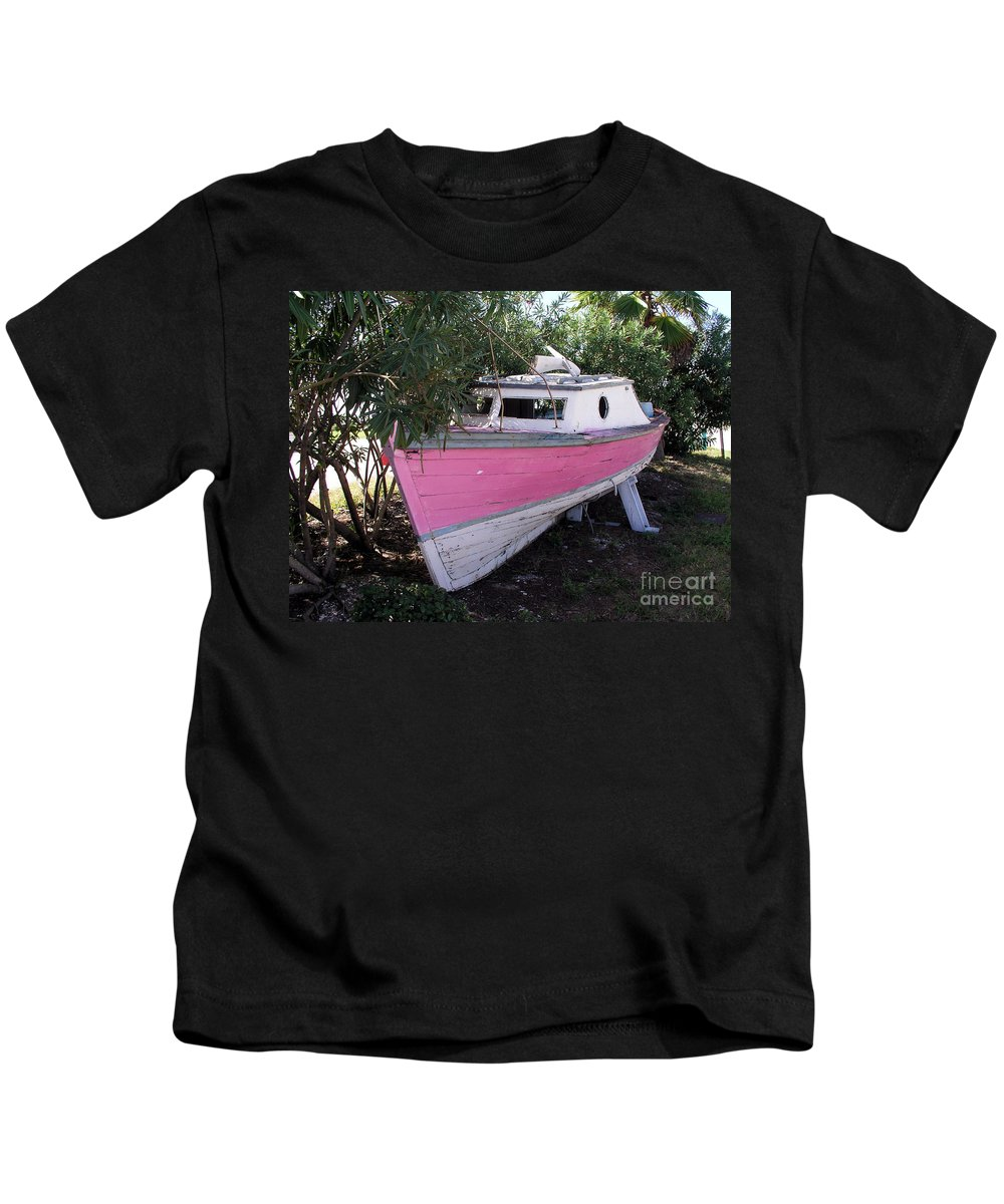 Boat; Old; Faded; Dreams; Pink; Beached; Greek; Wrecked; Paint; Florida; Ship; Flotsom; Grounded; Dr Kids T-Shirt featuring the photograph Beached Dreams At Port Canaveral by Allan Hughes