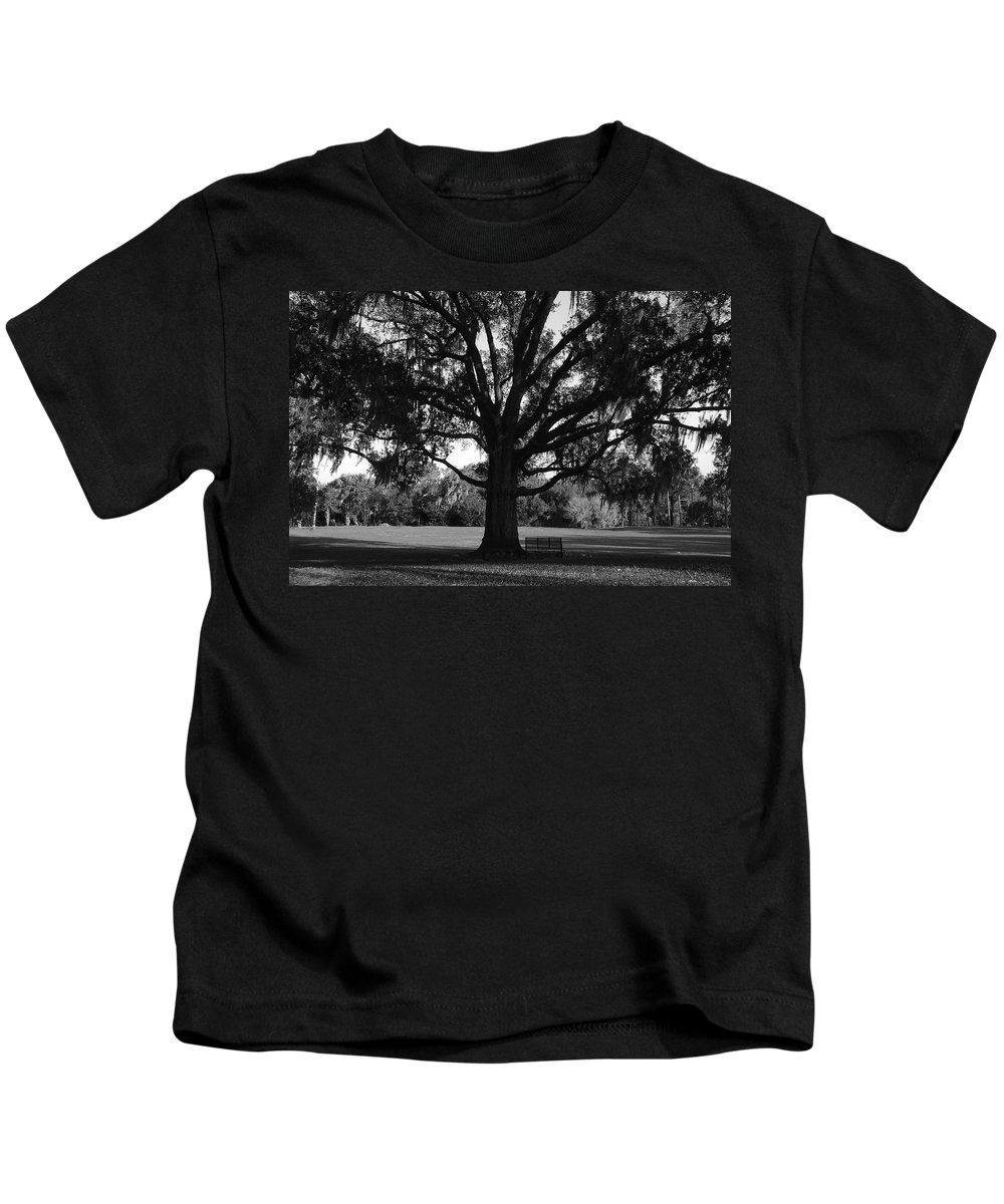 Park Bench Kids T-Shirt featuring the photograph Bench Under Oak by David Lee Thompson