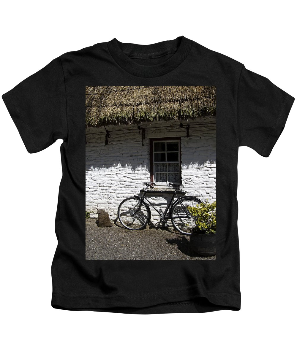Irish Kids T-Shirt featuring the photograph Bike At The Window County Clare Ireland by Teresa Mucha