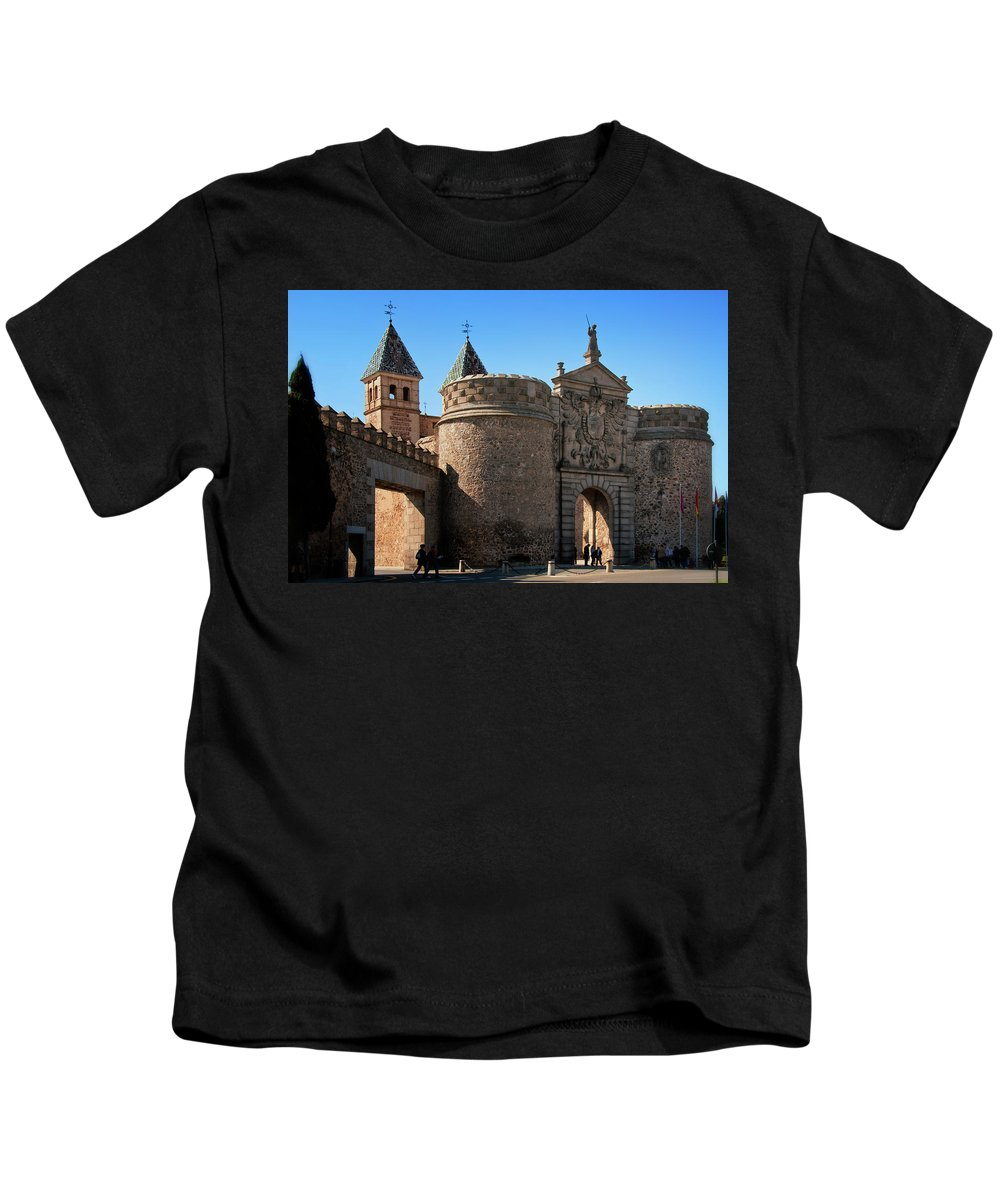Ages Kids T-Shirt featuring the photograph Bisagra Gate Toledo Spain by Joan Carroll