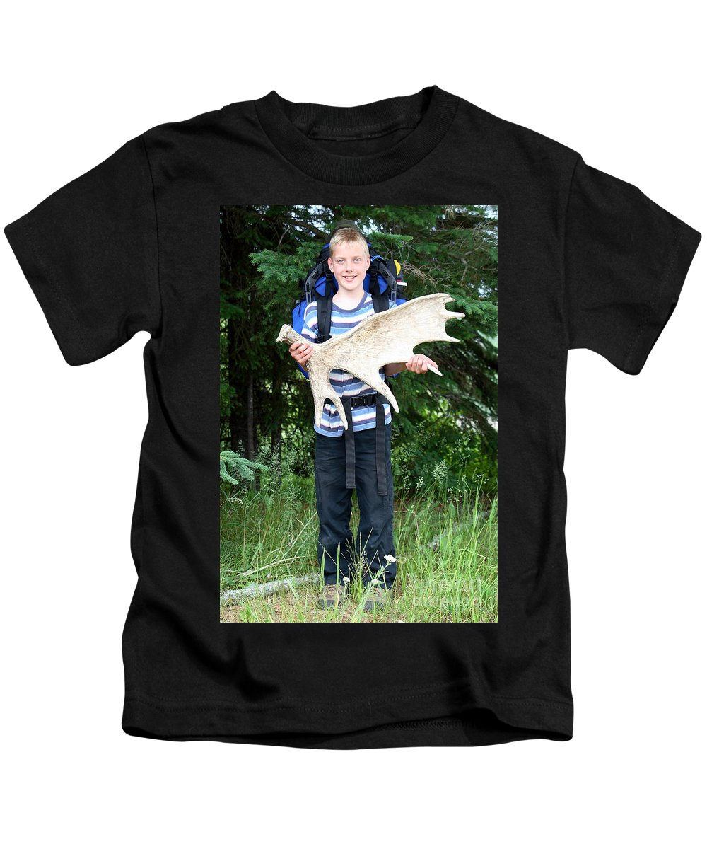 Boy Kids T-Shirt featuring the photograph Boy Holding A Moose Antler by Ted Kinsman