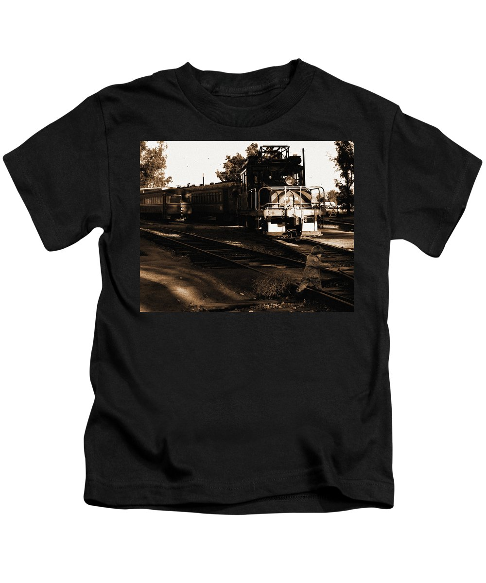 Train Kids T-Shirt featuring the photograph Boy On The Tracks by Anthony Jones