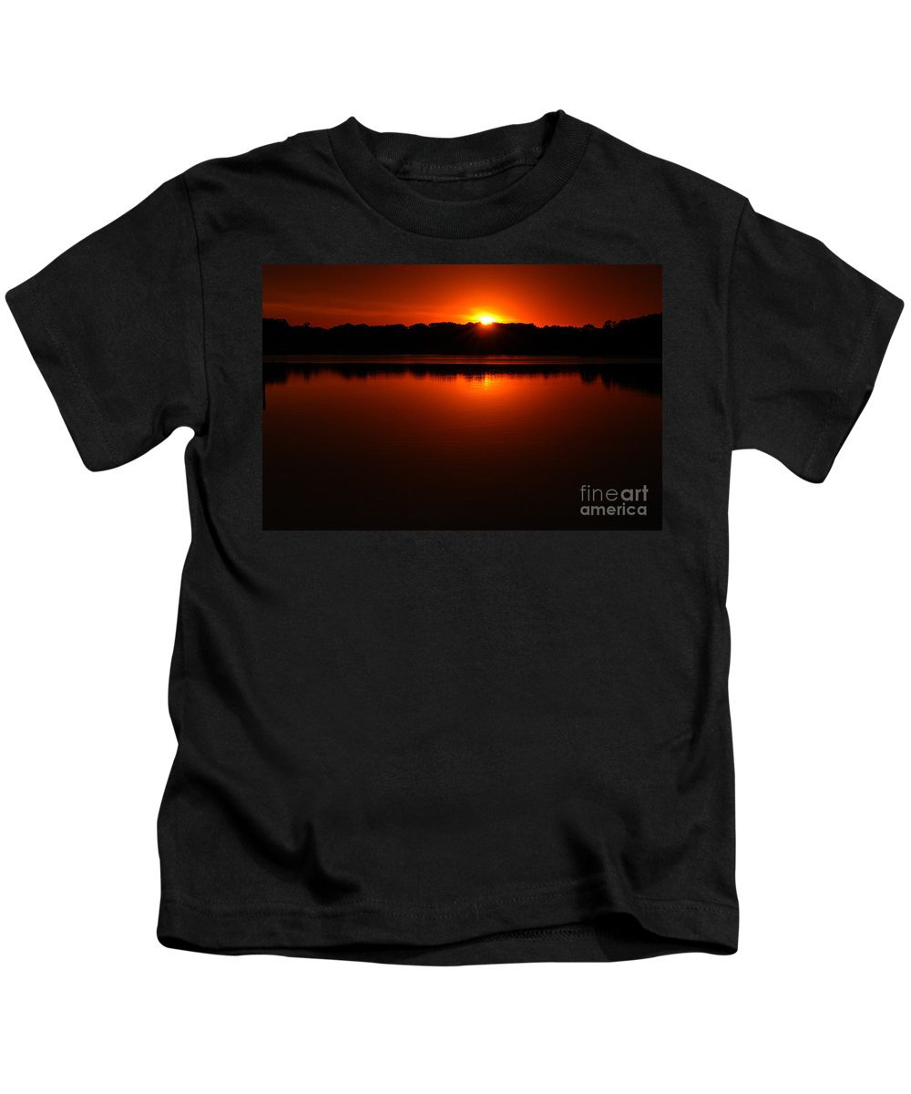 Clay Kids T-Shirt featuring the photograph Burnt Orange Sunset On Water by Clayton Bruster