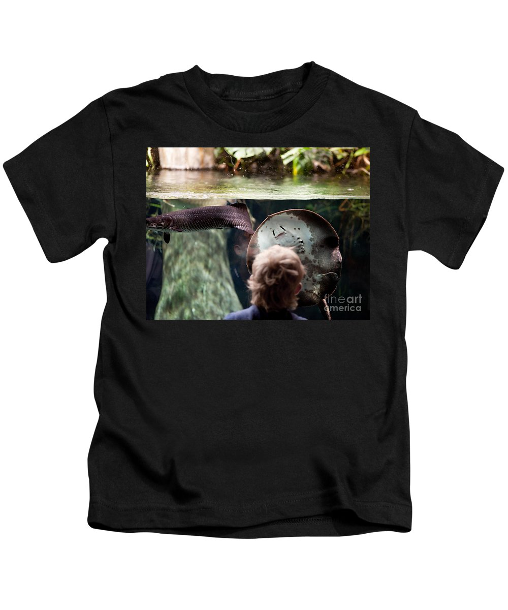 Paludarium Kids T-Shirt featuring the photograph Child And Ray Fish In Paludarium by Arletta Cwalina
