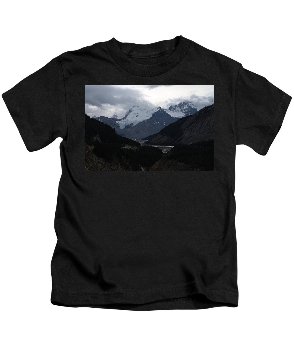 Jasper National Park Kids T-Shirt featuring the photograph Clouds And Snow In The Mountains by Larry Ricker