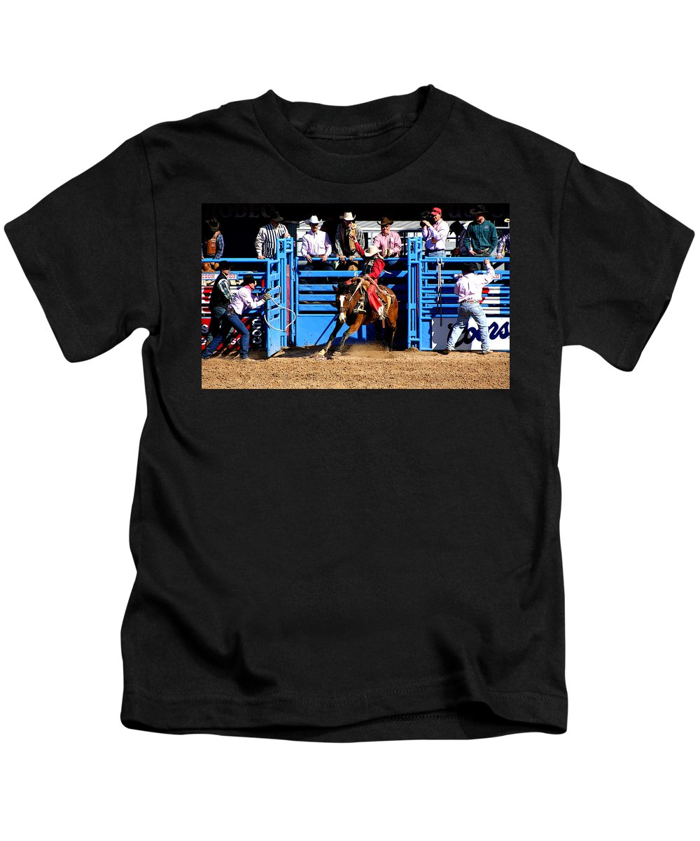 Rodeo. Rodeos Kids T-Shirt featuring the photograph Coming Out Party by Joe Kozlowski