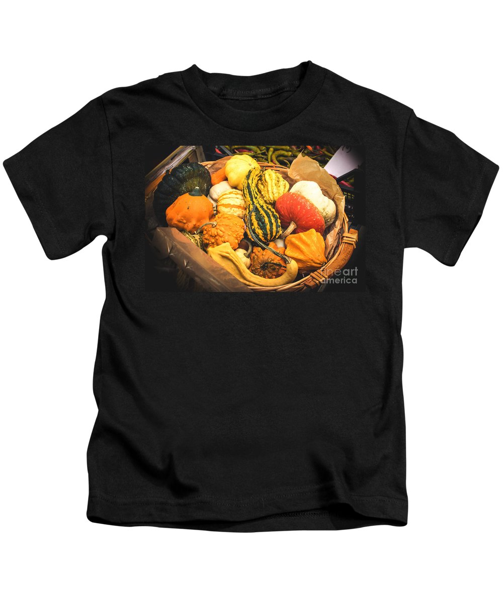 Agriculture Kids T-Shirt featuring the photograph Composition Of Various Gourds In A Basket With Vignetting by Luca Lorenzelli