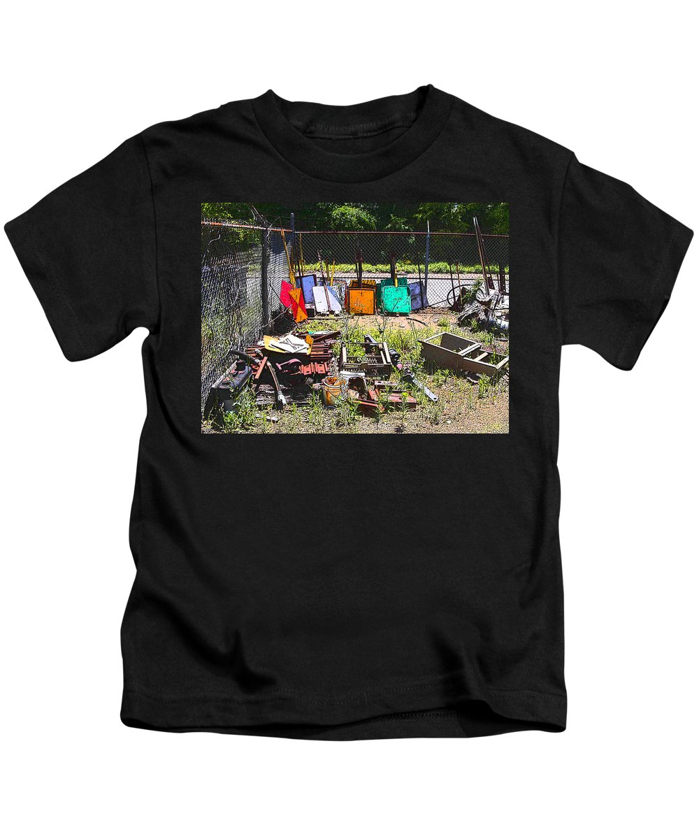 Train Kids T-Shirt featuring the photograph Discarded Signs At The Train Station by Anne Cameron Cutri