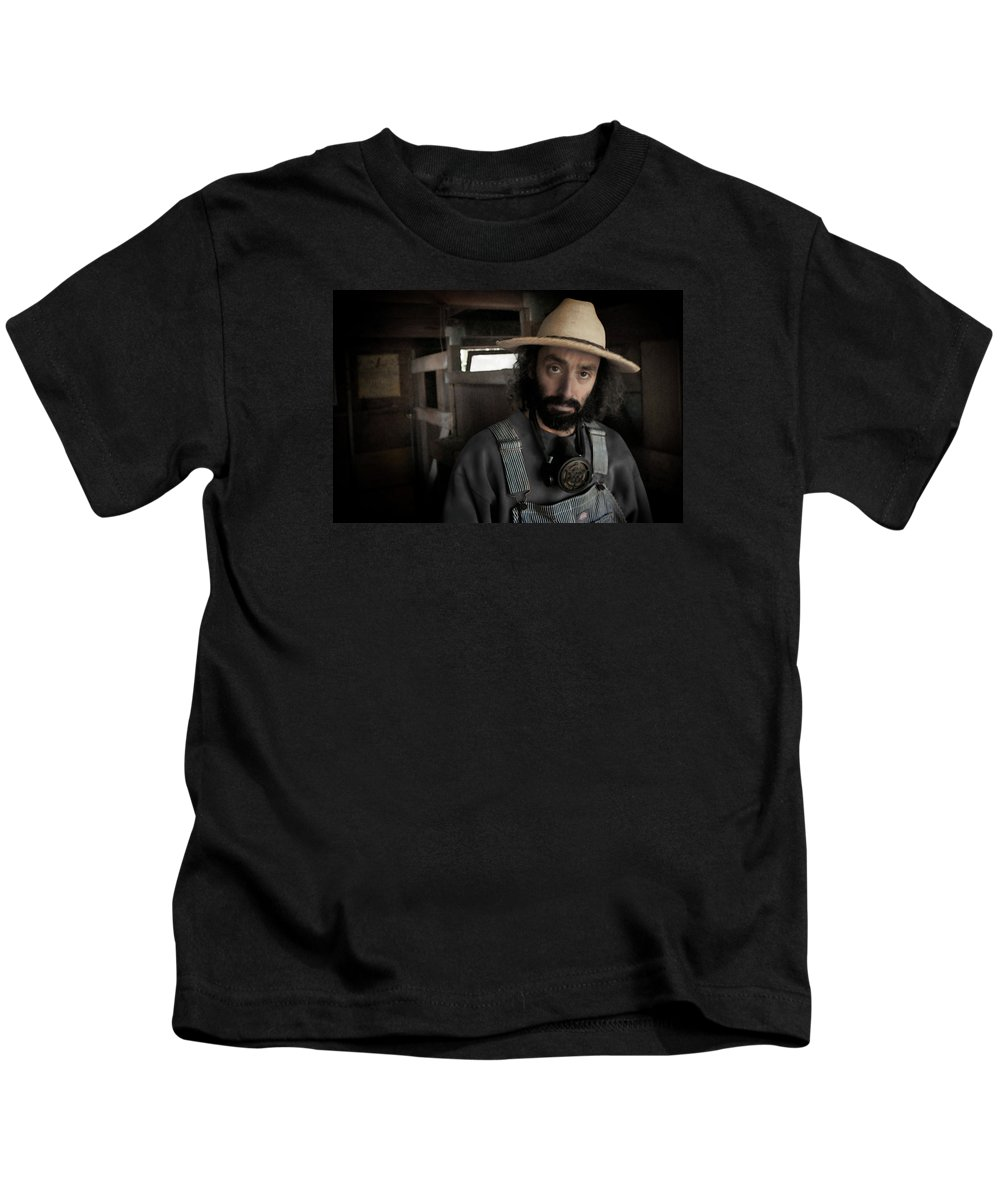 Farm Worker Kids T-Shirt featuring the photograph Farm Worker by Grant Groberg