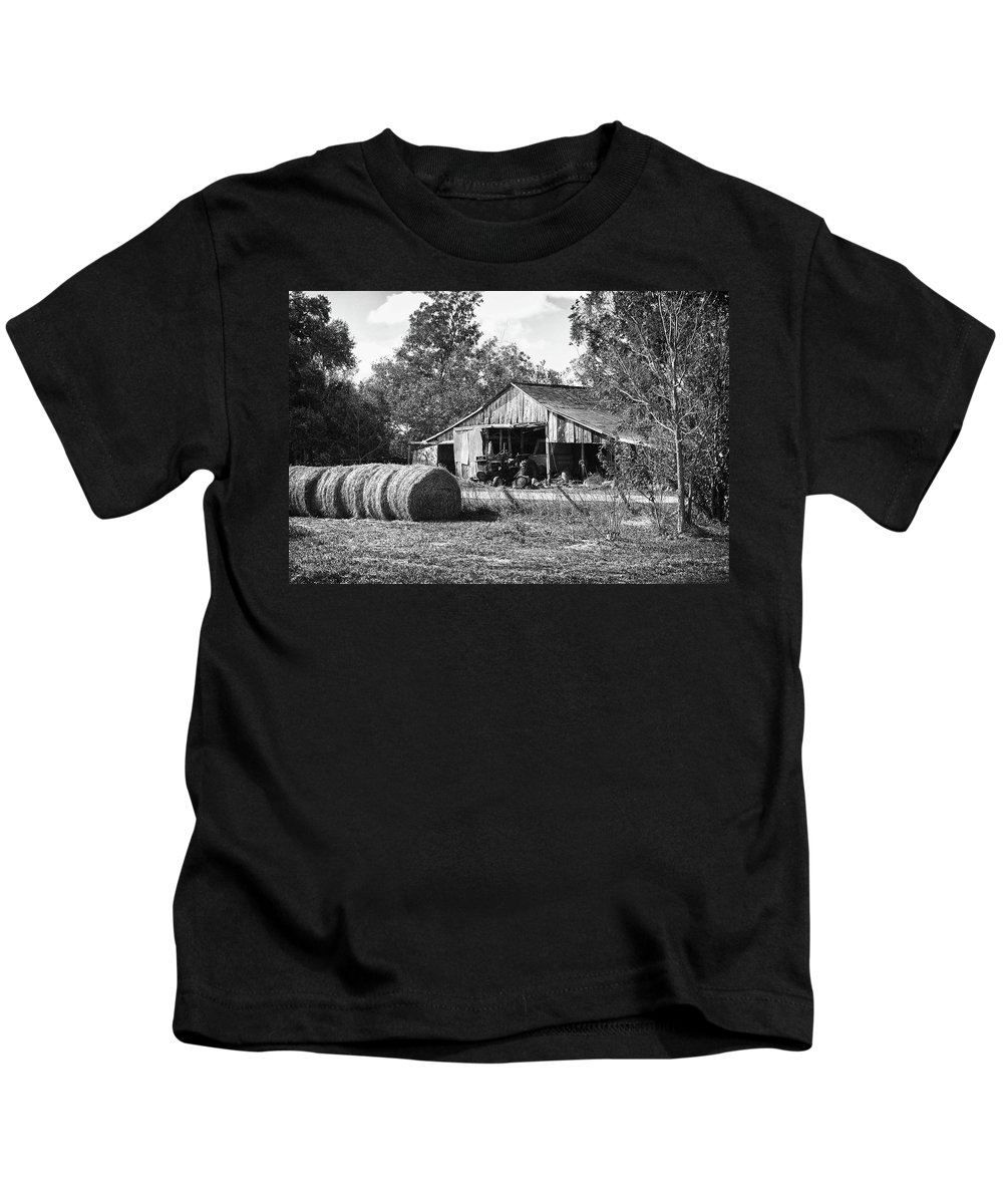 Alabama Photographer Kids T-Shirt featuring the digital art Hay And The Old Barn - Bw by Michael Thomas
