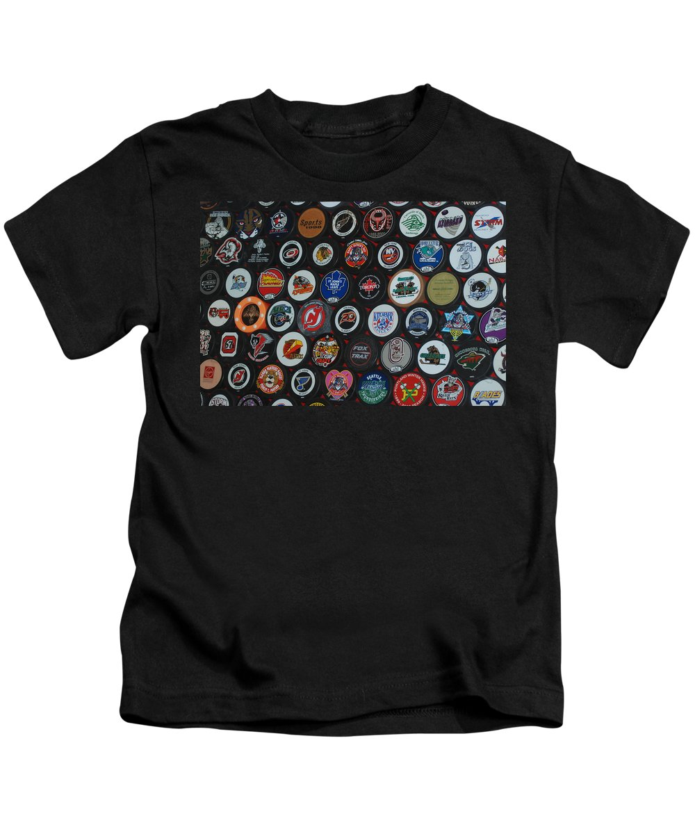 Pop Art Kids T-Shirt featuring the photograph Hockey Pucks by Rob Hans