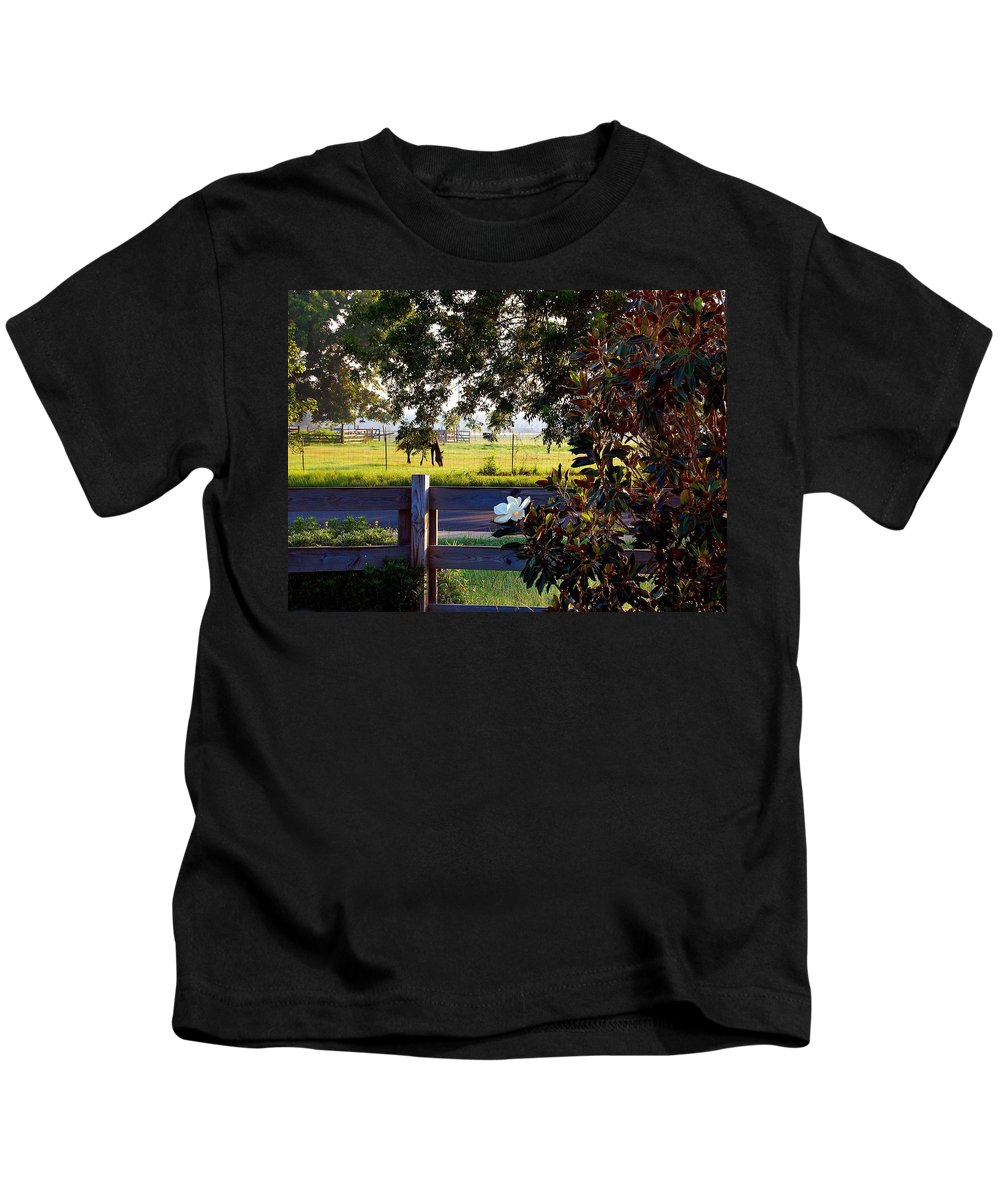 Pelican Kids T-Shirt featuring the photograph Horse And Flower by Michael Thomas