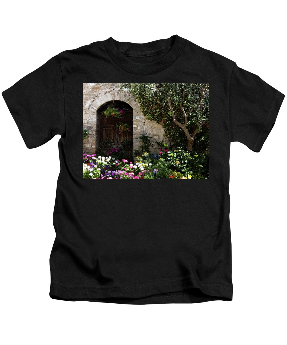 Flower Kids T-Shirt featuring the photograph Italian Front Door Adorned With Flowers by Marilyn Hunt