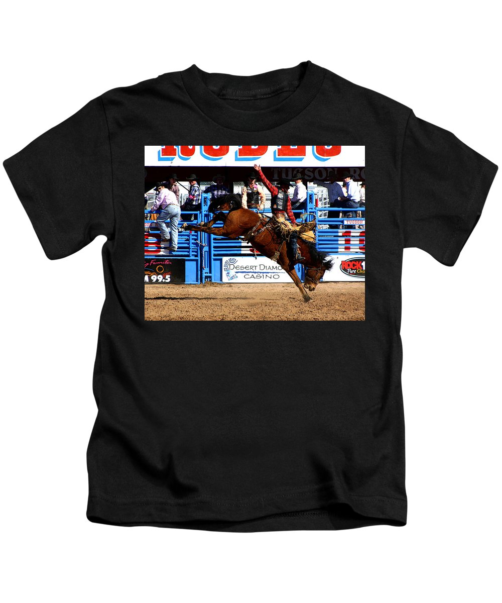 Rodeo. Rodeos Kids T-Shirt featuring the photograph Just Two More Seconds To Go by Joe Kozlowski