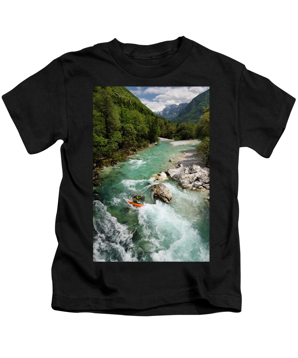 Turquoise Kids T-Shirt featuring the photograph Kayaker Shooting The Cold Emerald Green Alpine Water Of The Uppe by Reimar Gaertner