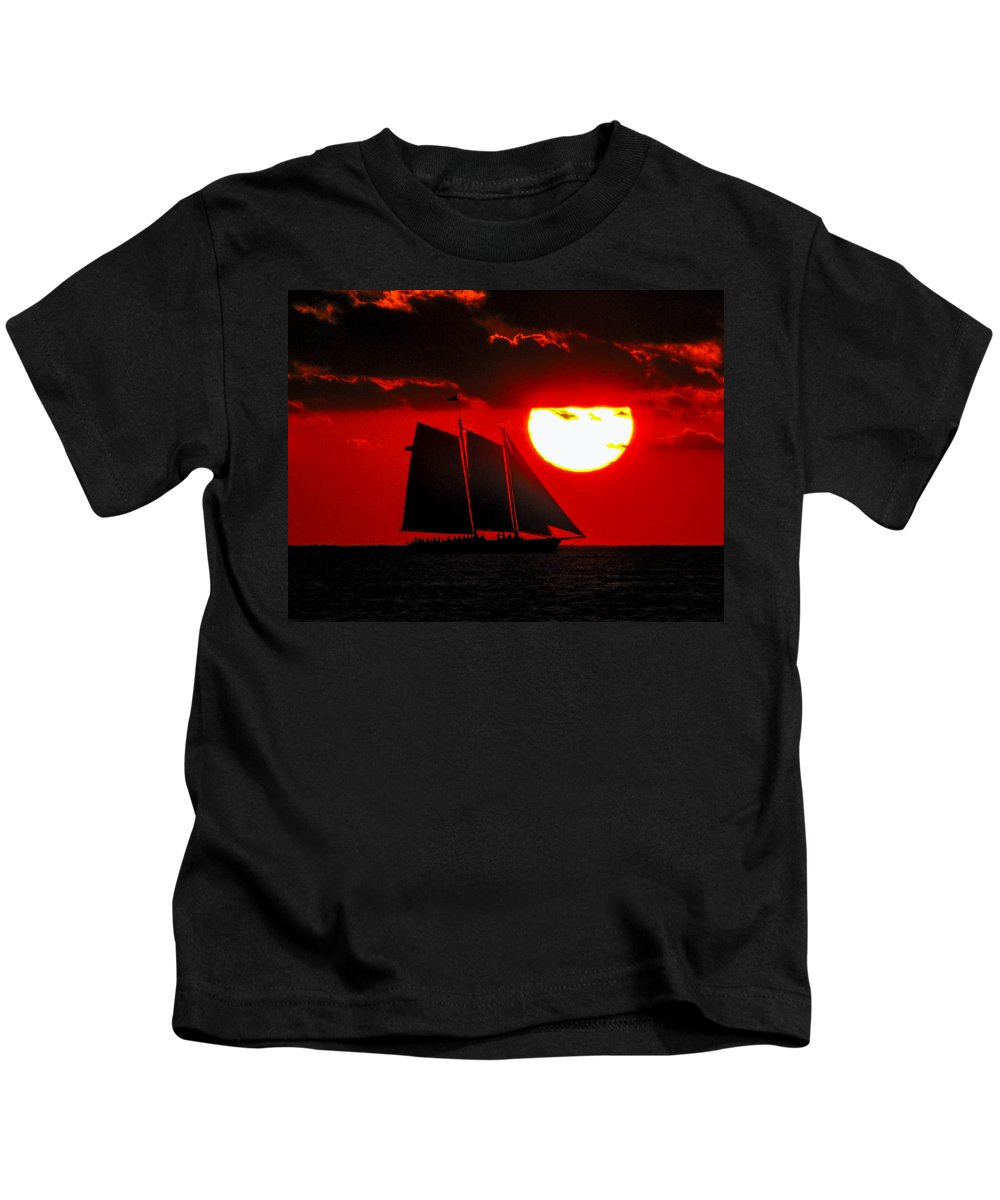 Orange Kids T-Shirt featuring the photograph Key West Sunset Sail Silhouette by Bob Slitzan
