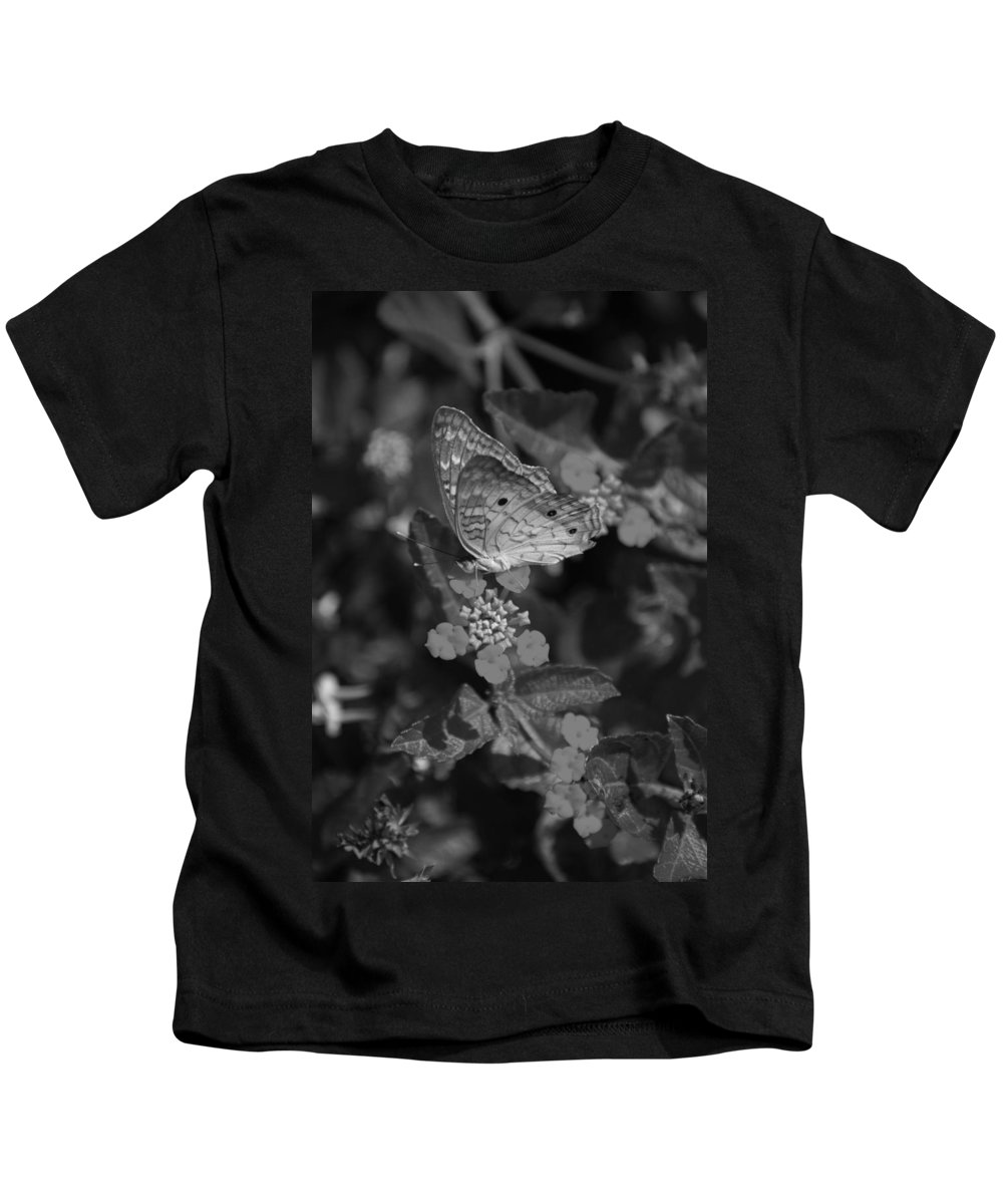 Black And White Kids T-Shirt featuring the photograph Landed by Rob Hans