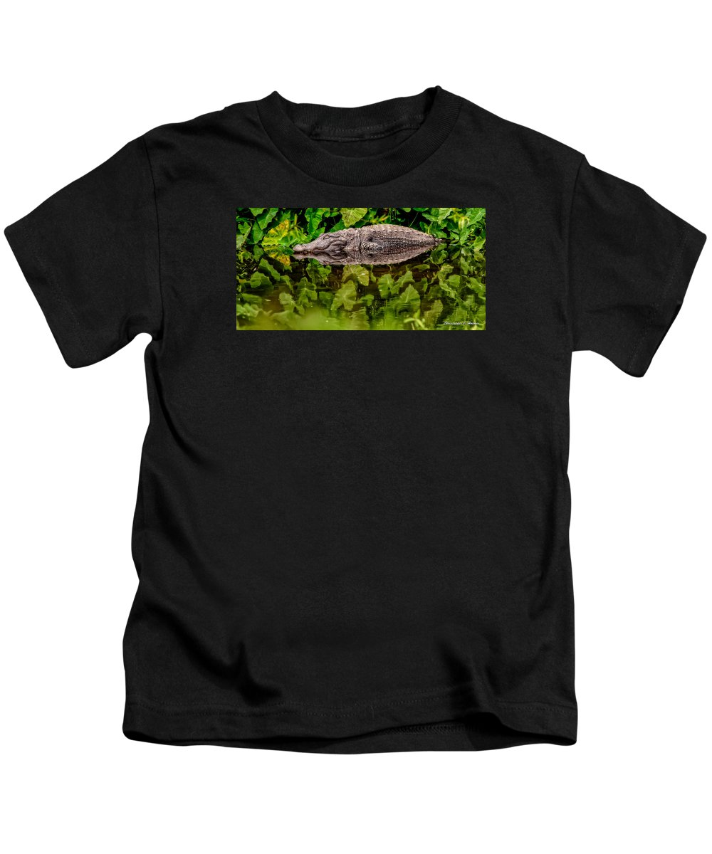 Alligator Kids T-Shirt featuring the photograph Let Sleeping Gators Lie by Christopher Holmes