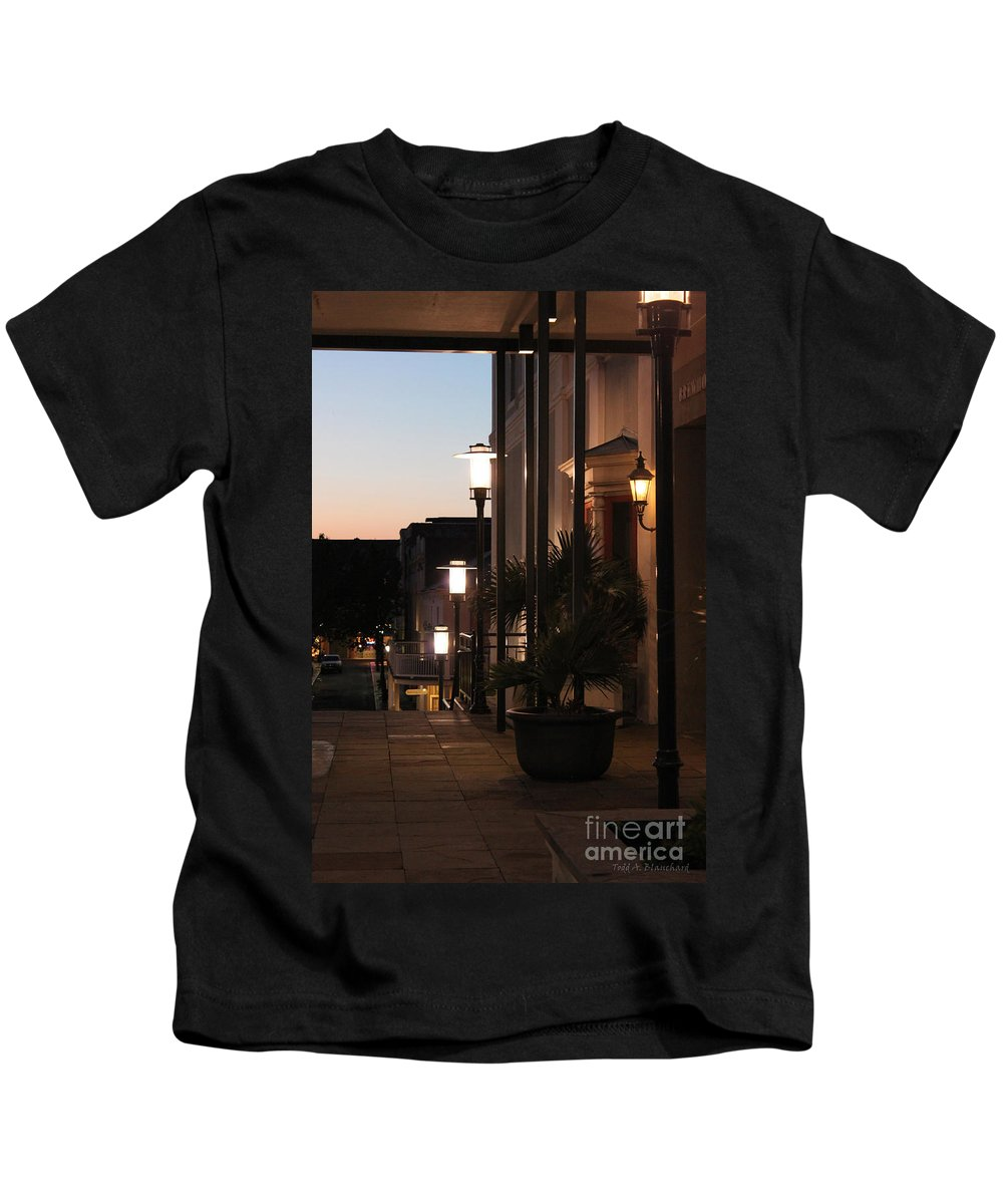 Architecture Kids T-Shirt featuring the photograph Lighted Walkway by Todd Blanchard