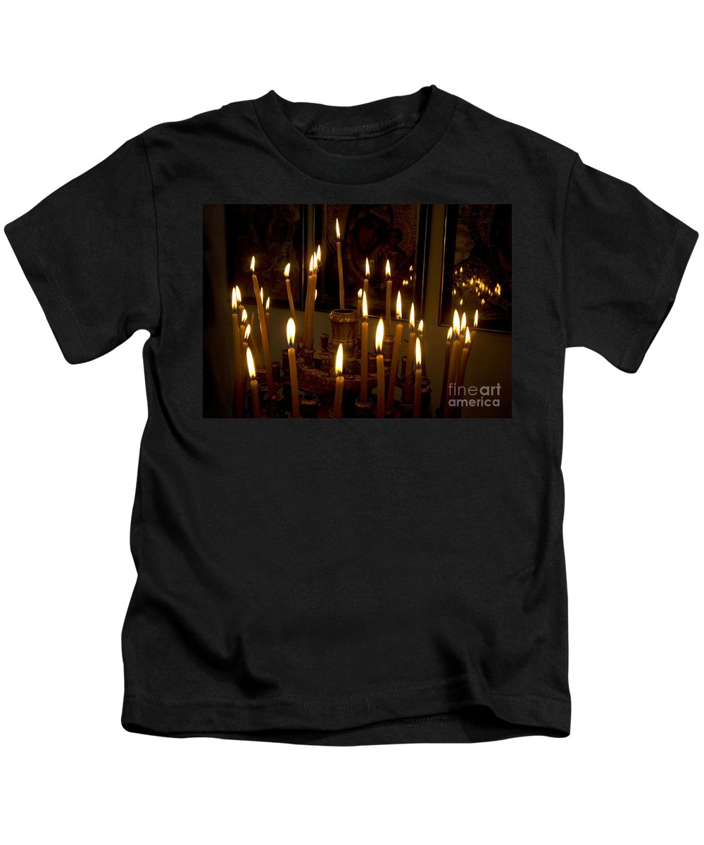 Lit Kids T-Shirt featuring the photograph lit Candles in church by Danny Yanai