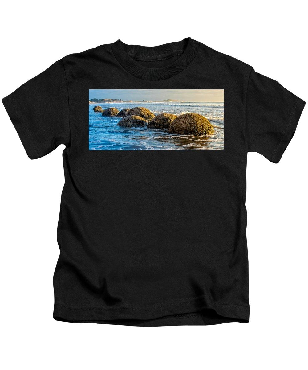 Moeraki Kids T-Shirt featuring the photograph Moeraki Boulders by Martin Capek