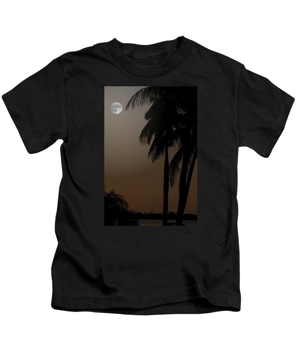 Moonlight Kids T-Shirt featuring the photograph Moonlight And Palms by Diane Merkle