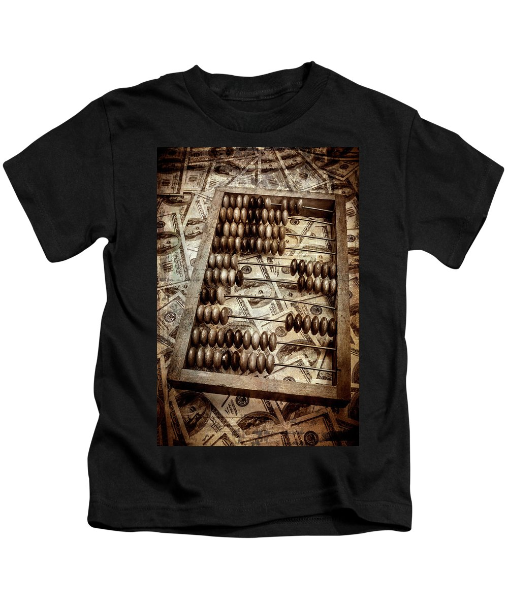 Abacus Kids T-Shirt featuring the photograph Old Accounting Wooden Abacus by Yuliya Pravdyuk