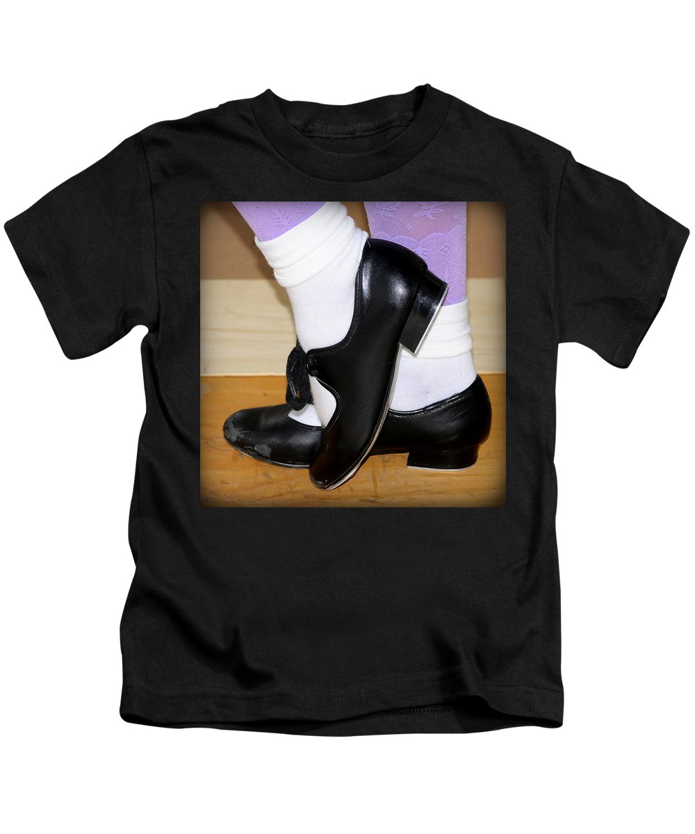 Black Kids T-Shirt featuring the photograph Old Tap Dance Shoes With White Socks And Wooden Floor by Pedro Cardona Llambias