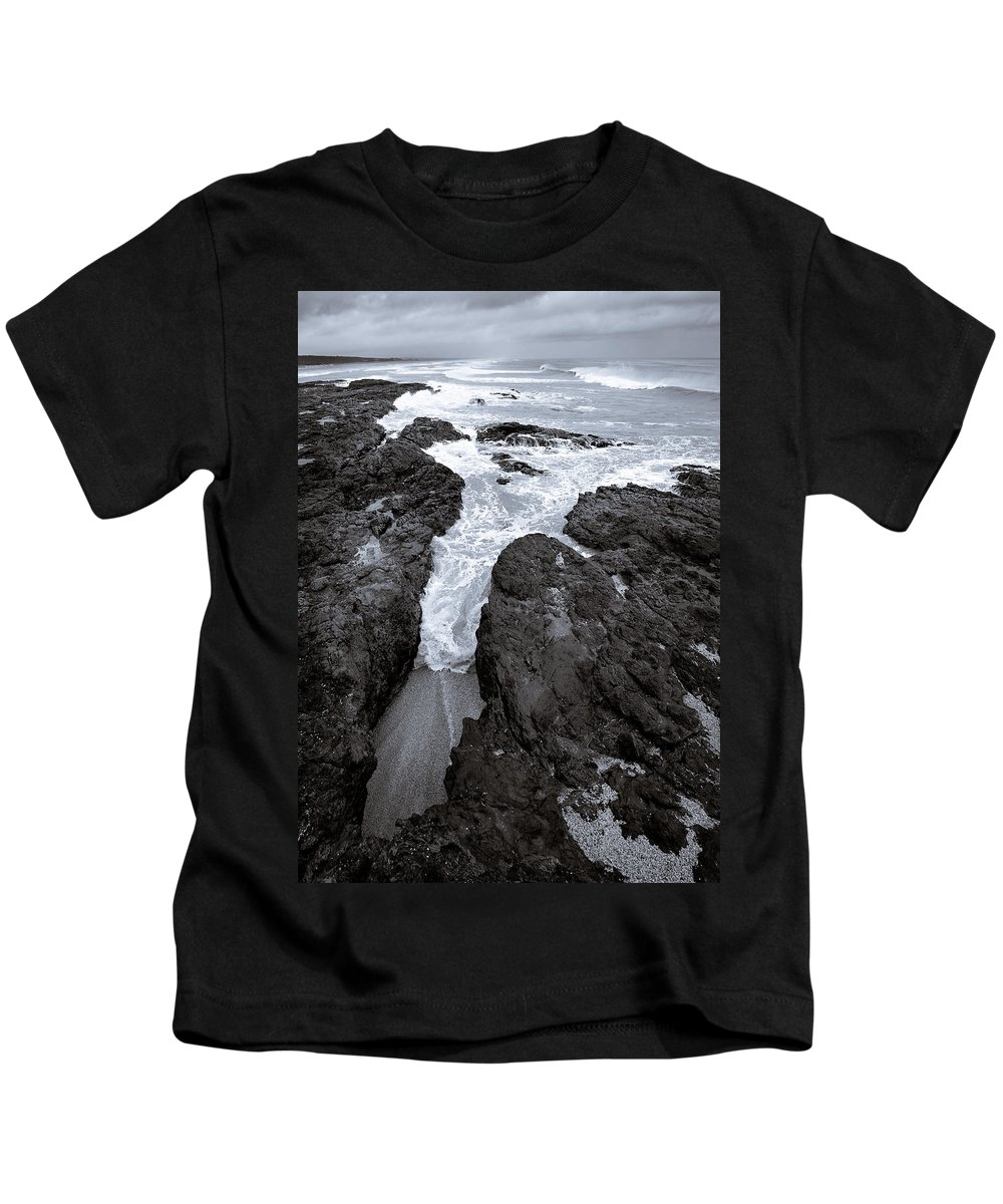 New Zealand Kids T-Shirt featuring the photograph On The Rocks by Dave Bowman