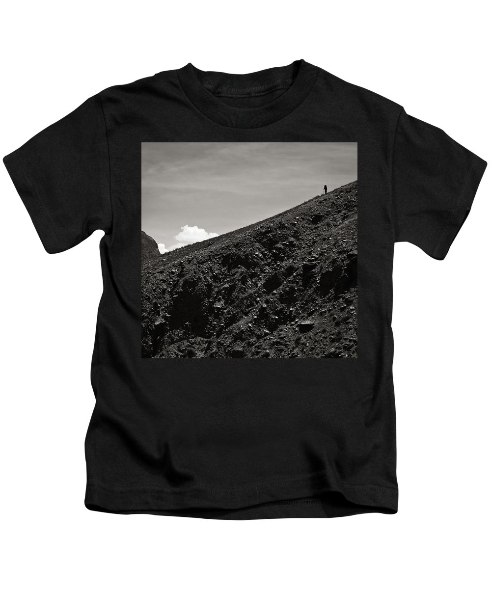 Alone Kids T-Shirt featuring the photograph On The Slope by Konstantin Dikovsky