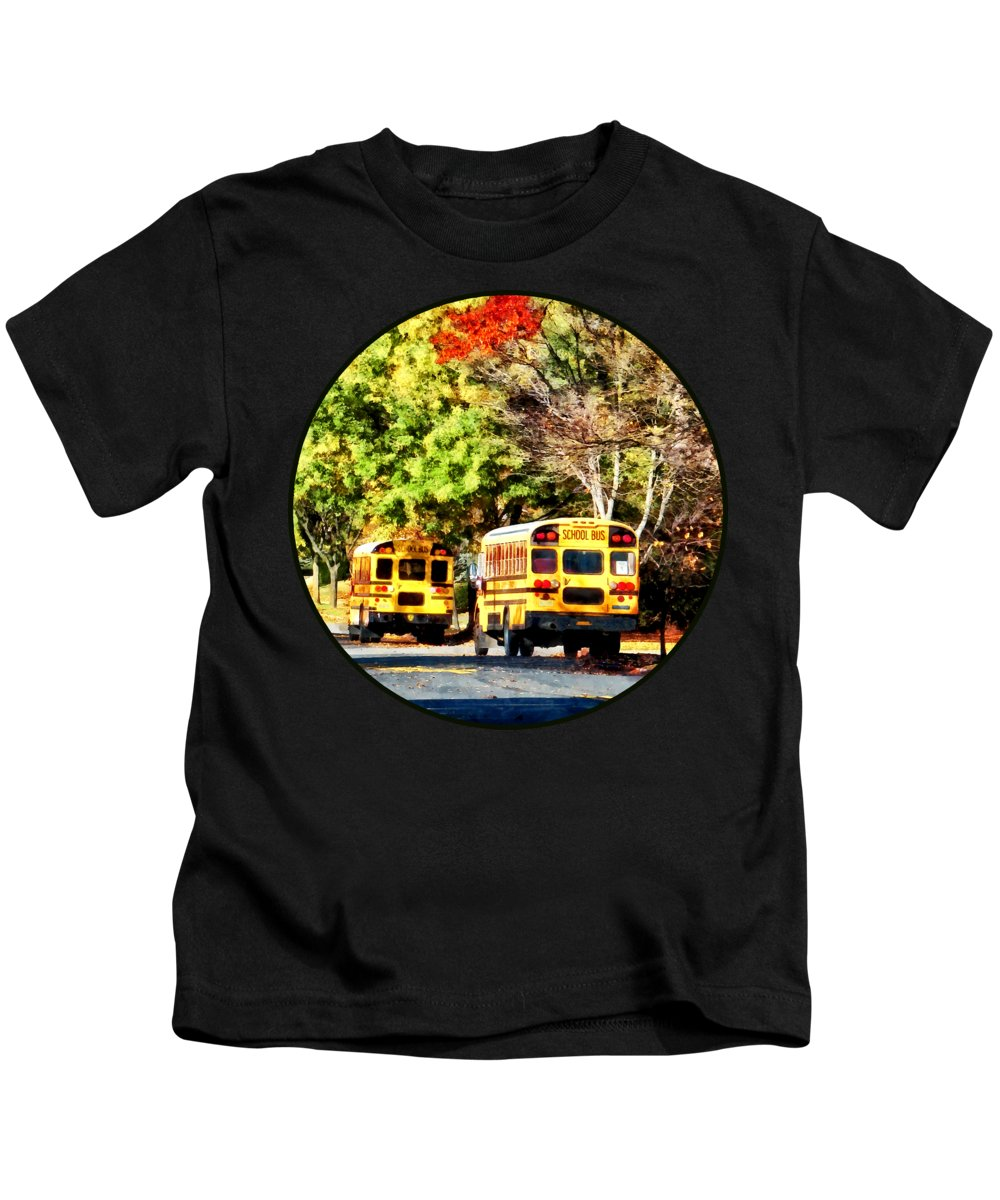 Bus Kids T-Shirt featuring the photograph Parked School Buses by Susan Savad