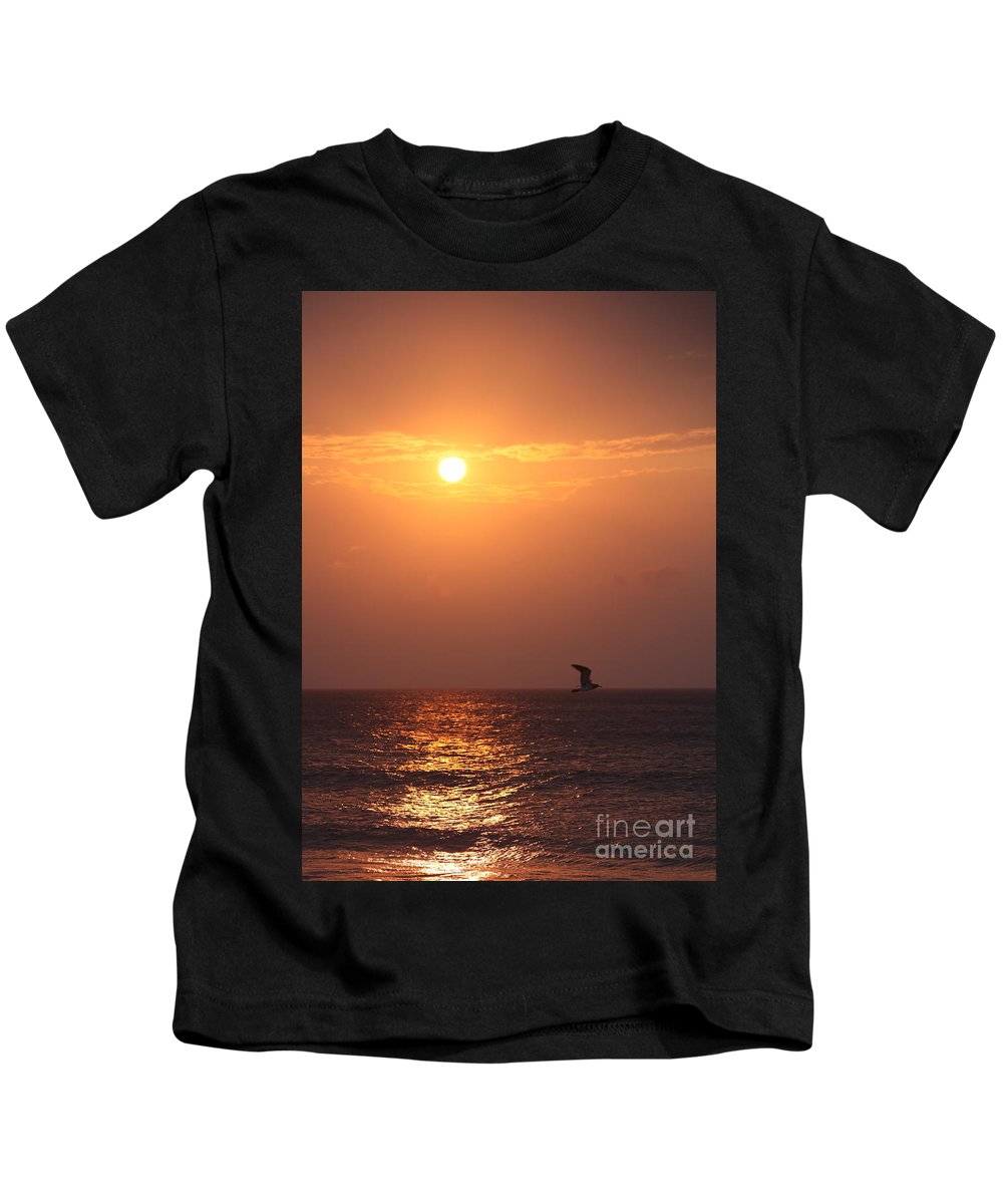 Birds Kids T-Shirt featuring the photograph Peach Sunrise and Bird in Flight by Nadine Rippelmeyer
