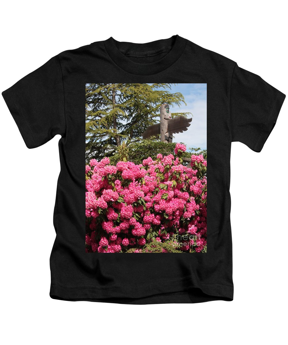 Northwest Kids T-Shirt featuring the photograph Pink Rhododendrons With Totem Pole by Carol Groenen