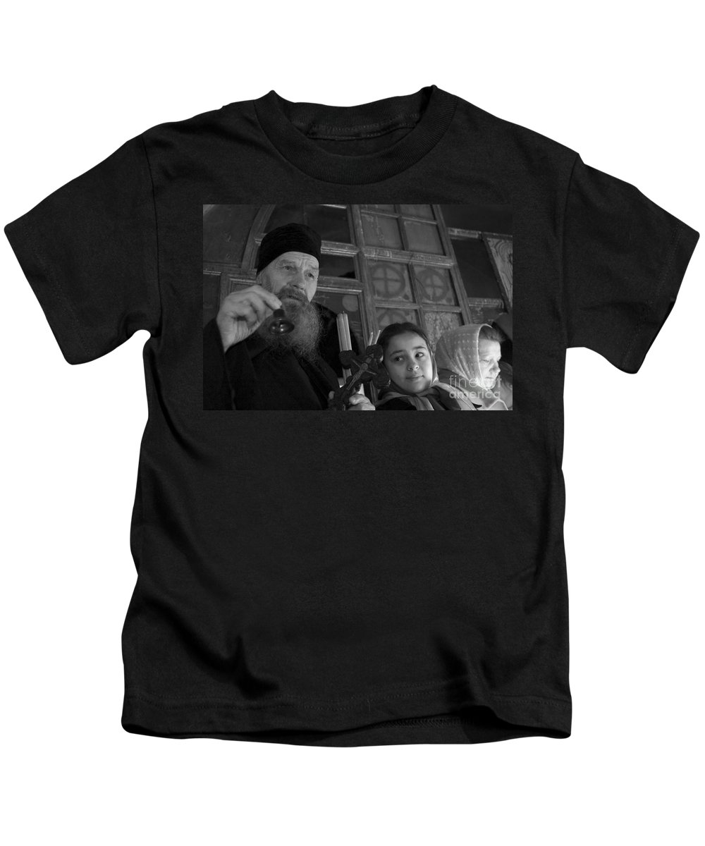 Christian Kids T-Shirt featuring the photograph Priest And A Young Girl by Nahum Budin